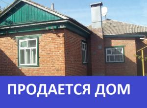 Продается большой кирпичный дом с просторной кухней и высокими потолками в Морозовске